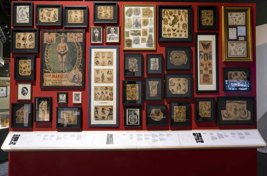 Wall of rare Tattoo flash, part of Tattoo British Tattoo Art Revealed at The National Maritime Museum Cornwall in Falmouth